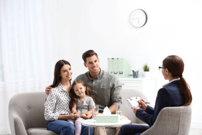small family talking with their doctor