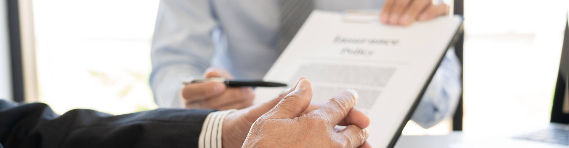 a man's hand and a contract paper
